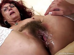 mature up porn Naughty Dutch housewife with big pussylips sticking a vibrator up her  ass.